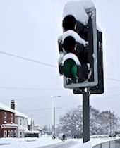 snowy traffic lights